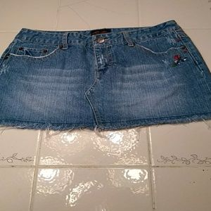 Size 5/6 Denim mini-skirt.     337